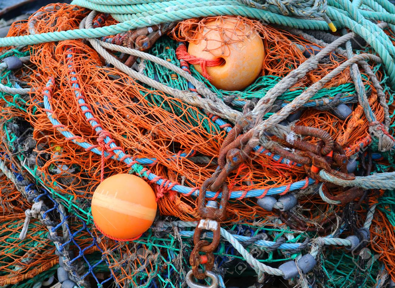 Pile Of Colorful Fishing Nets And Chains Stock Photo, Picture And ...
