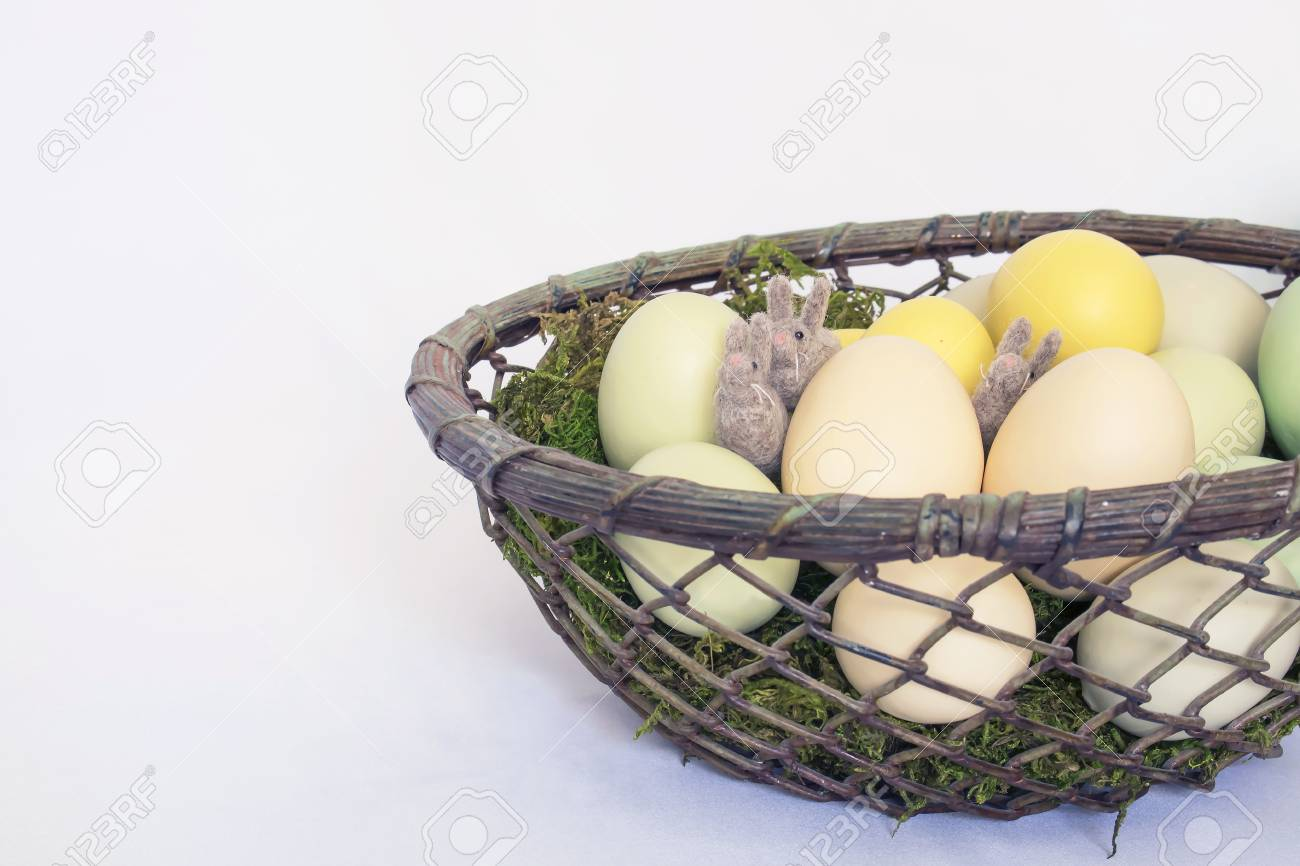 Rustic Wire Basket Filled With Colored Eggs And Three Tiny Rabbits ...