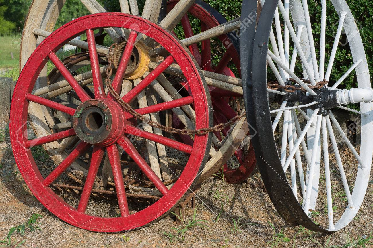 Old Wagon Wheels Chained Together. Stock Photo   40802878