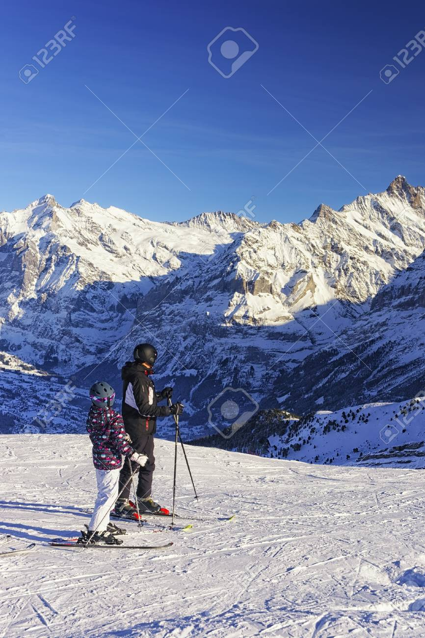 Father and kid on ski at winter sport resort in swiss alps stock father and kid on ski at winter sport resort in swiss alps stock photo 32885813 publicscrutiny Gallery