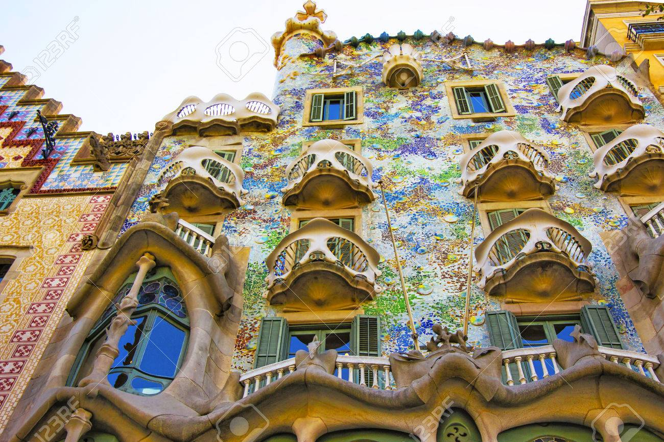 BARCELONA, SPAIN - AUGUST 14, 2011: Balconies of Casa Batllo building in Barcelona in Spain. It is also called as House of Bones. It was designed by Antoni Gaudi, Spanish architect. - 55062823