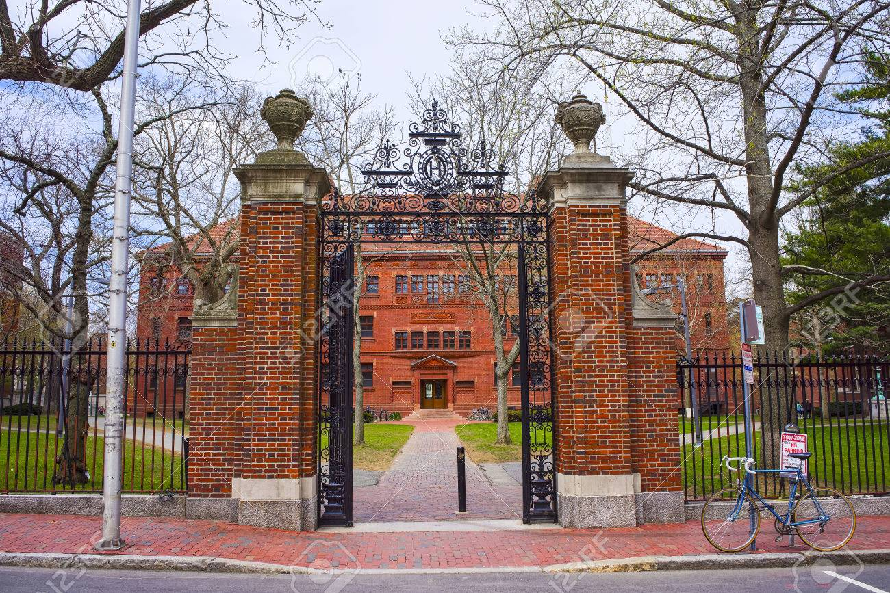 Entrance gate and East facade of Sever Hall at Harvard Yard in Harvard University in Cambridge, Massachusetts, MA, USA. It is used as the library, lecture hall and classroom for different courses. - 57810566