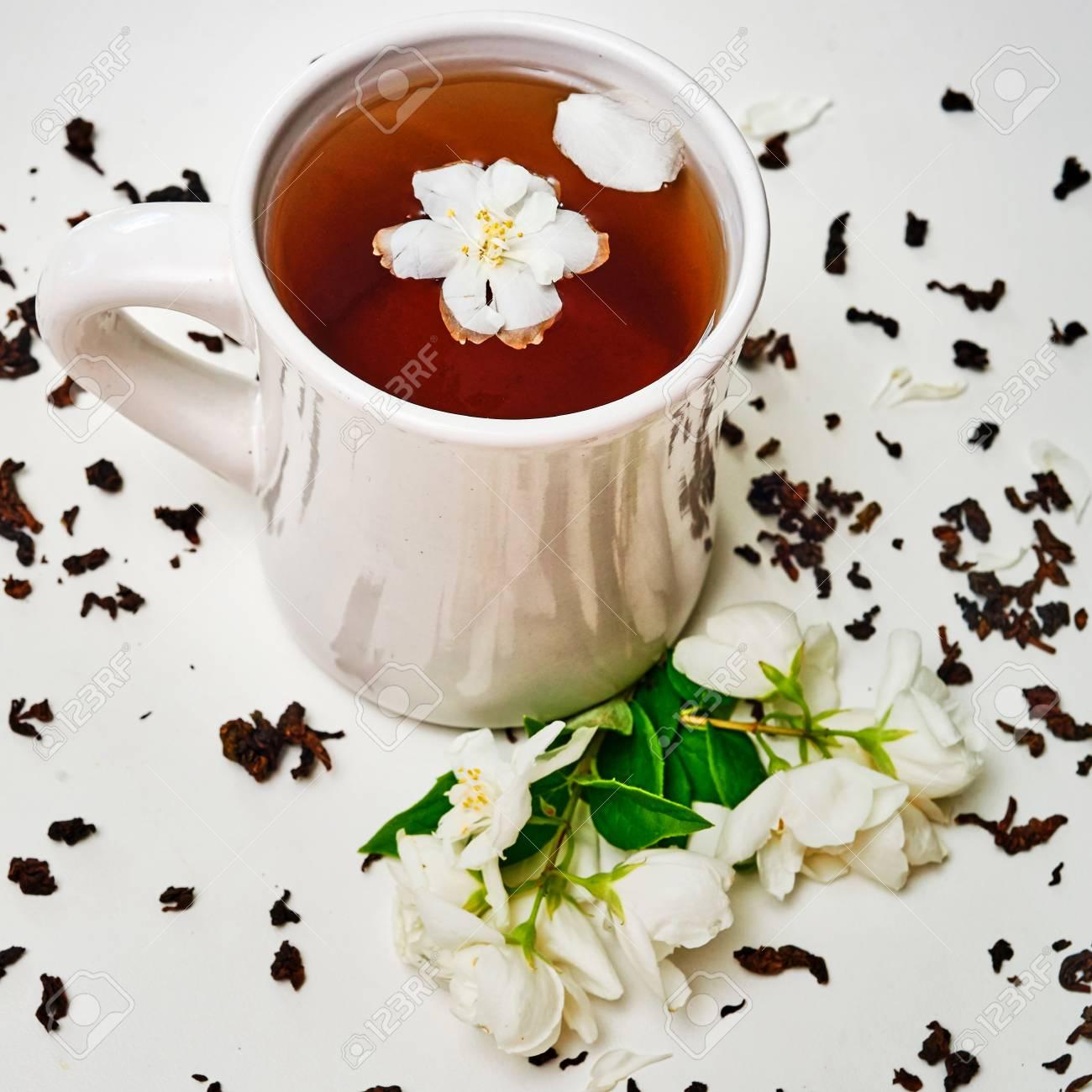 Tea Cup And Dried Jasmine Leaves And Fresh Fragrant Jasmine Flowers
