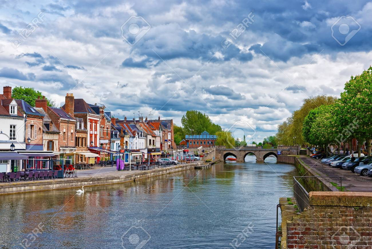 Amiens, France - May 9, 2012: Quay of Belu with traditional houses and Somme River in Amiens, Picardy, France. People on the background - 70158518