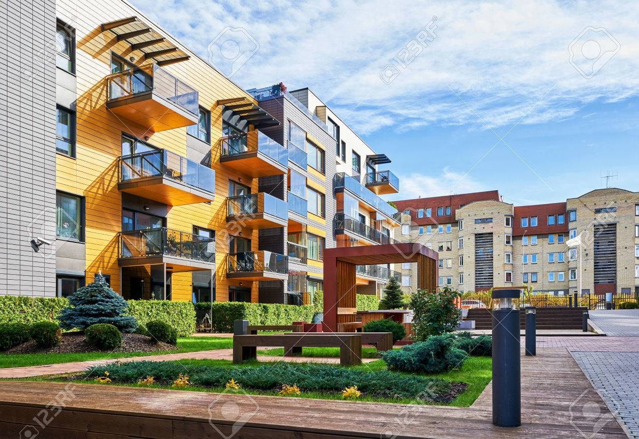 Modern complex of apartment residential buildings. With many benches and outdoor facilities. - 66178809