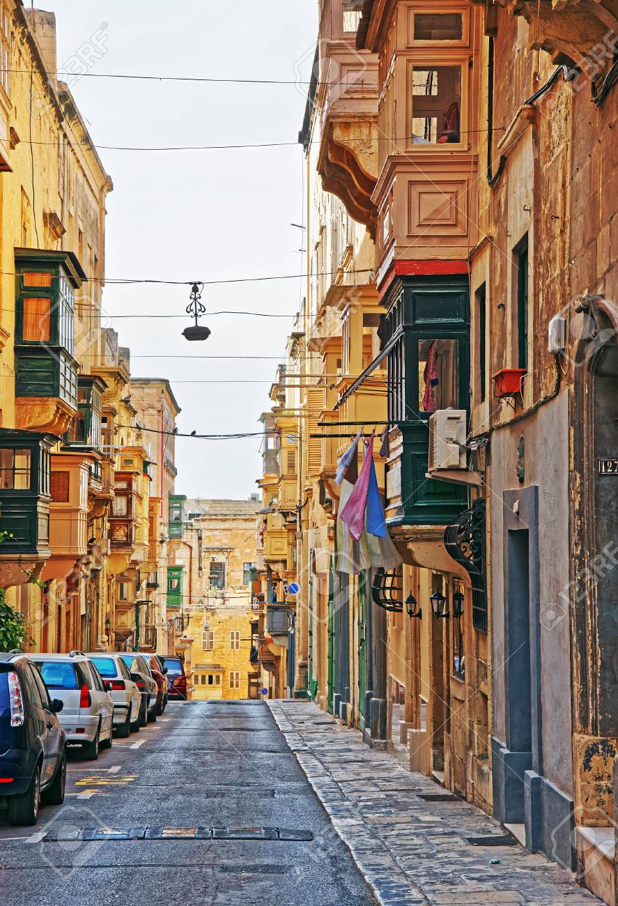 street with traditional houses at the old city center in valletta rh 123rf com