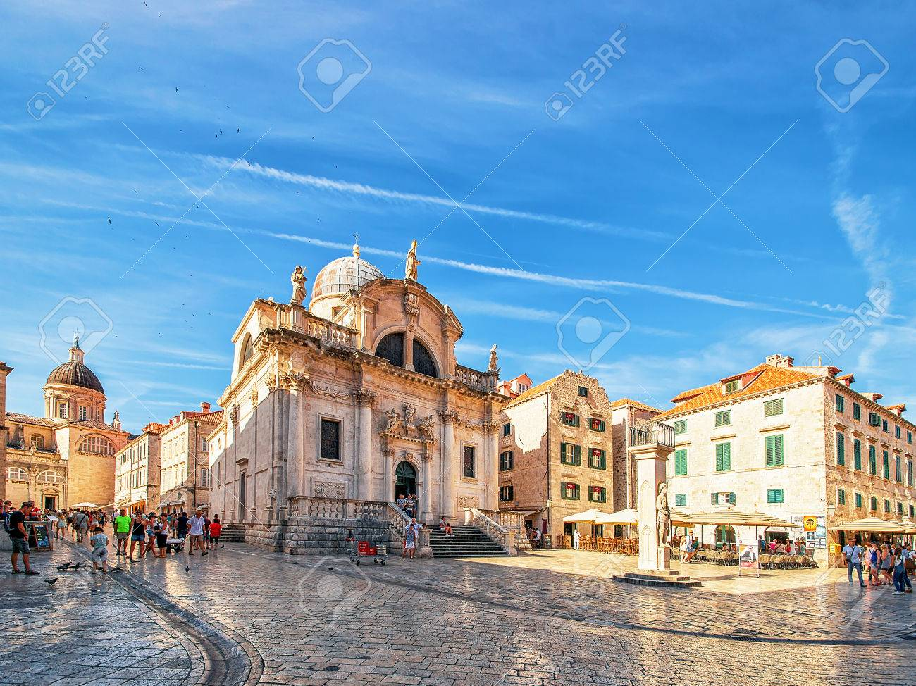 Dubrovnik, Croatia - August 20, 2016: Square at St Blaise Church and people in Stradun Street in the Old city of Dubrovnik, Croatia - 83198612
