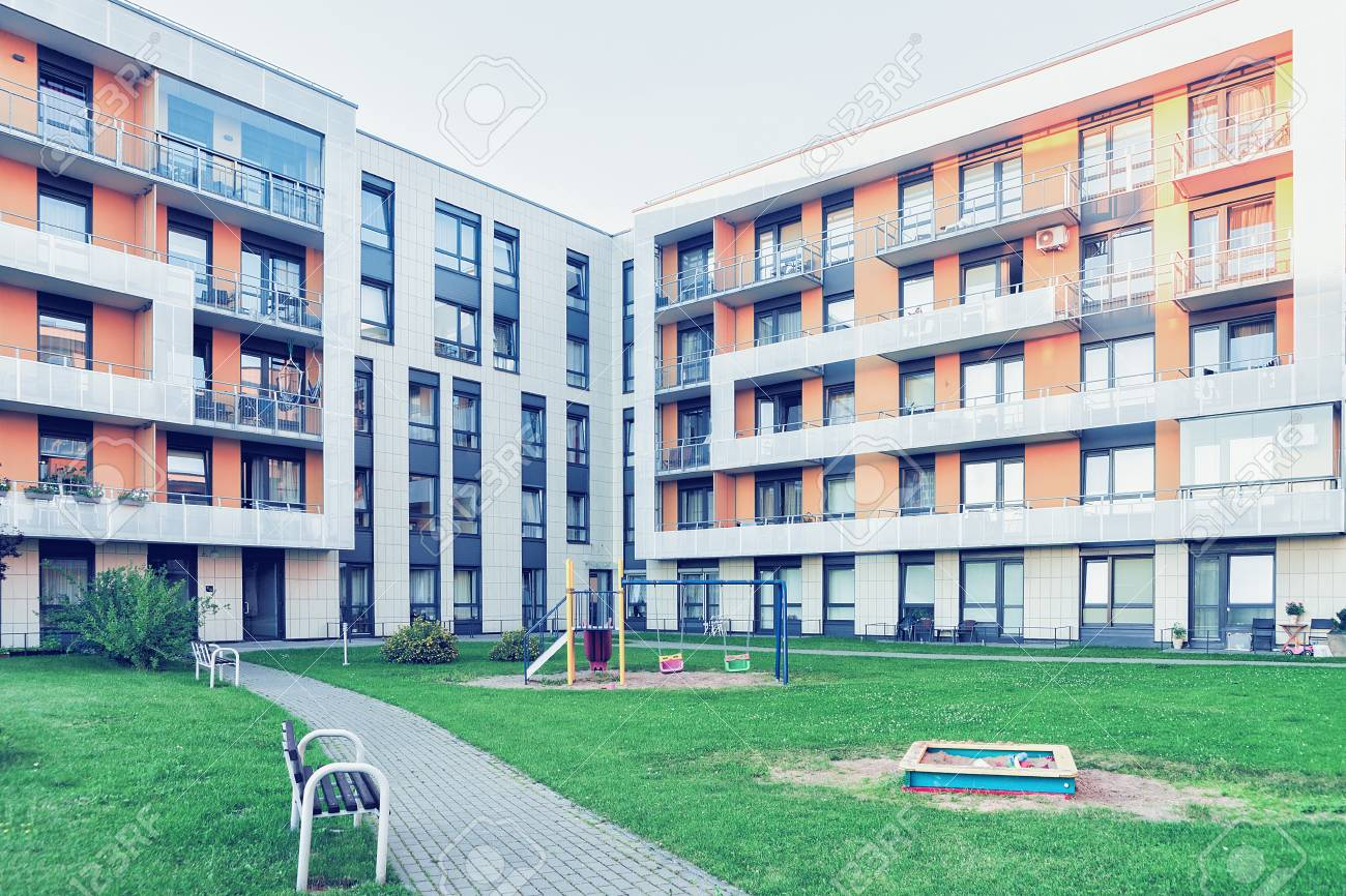 Vilnius, Lithuania - July 30, 2017: Complex of new apartment residential building with children playground as outdoor facilities. - 90728985