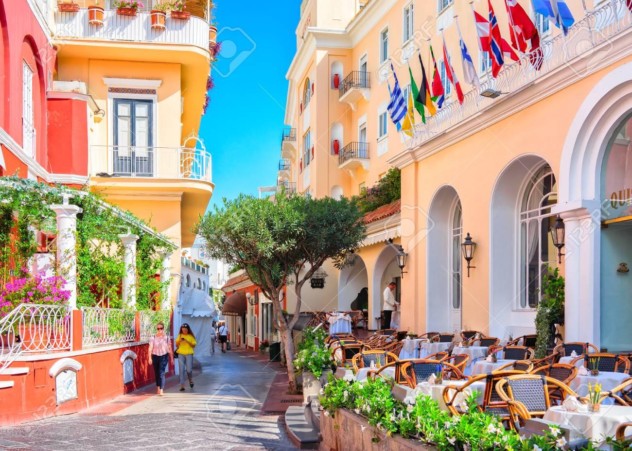 Capri, Italy - October 3, 2017: Tourists at Street cafes on Capri Island, Italy - 91487849