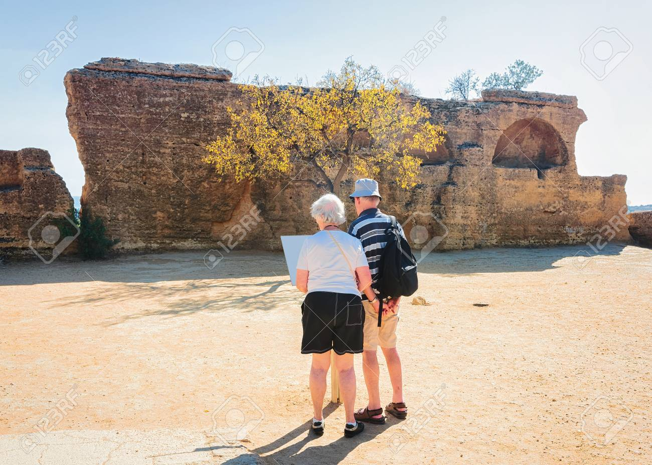 Agrigento Italy Map.Senior Couple Reading Map At Stone Necropolis In The Valley Of