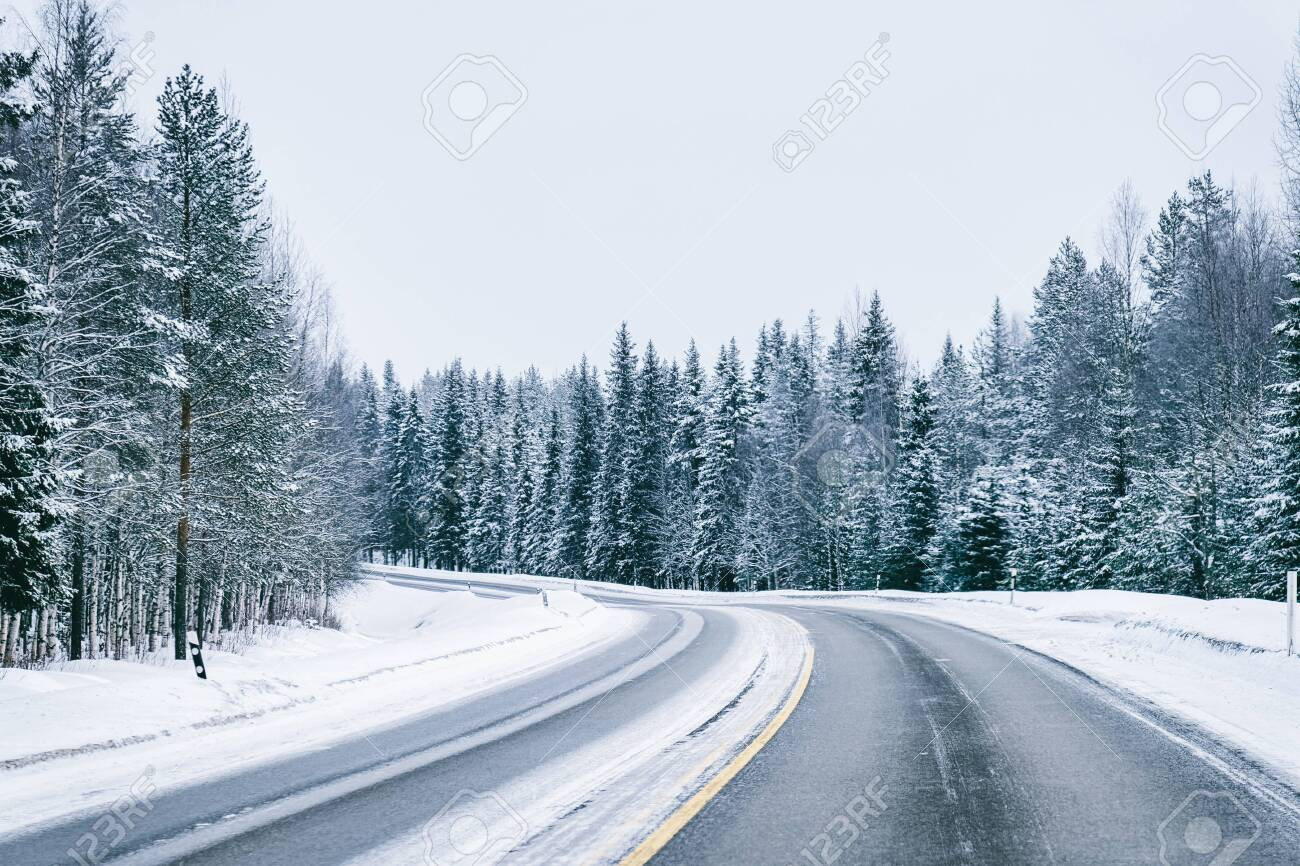 Car in a road at snowy winter Lapland, Rovaniemi, Finland - 115332306