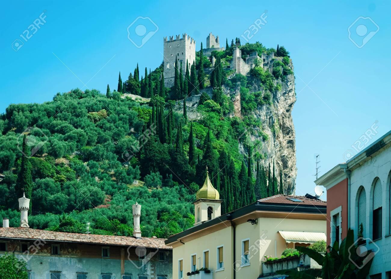Landscape with Castello di Arco on rock at Garda lake - 137425272