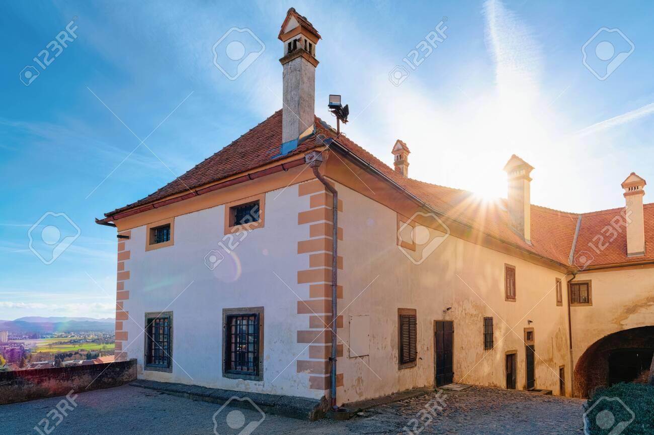 Sunset in Ptuj Castle in Slovenia. Facade of Building architecture in Ptujski grad in Slovenija. - 136855172