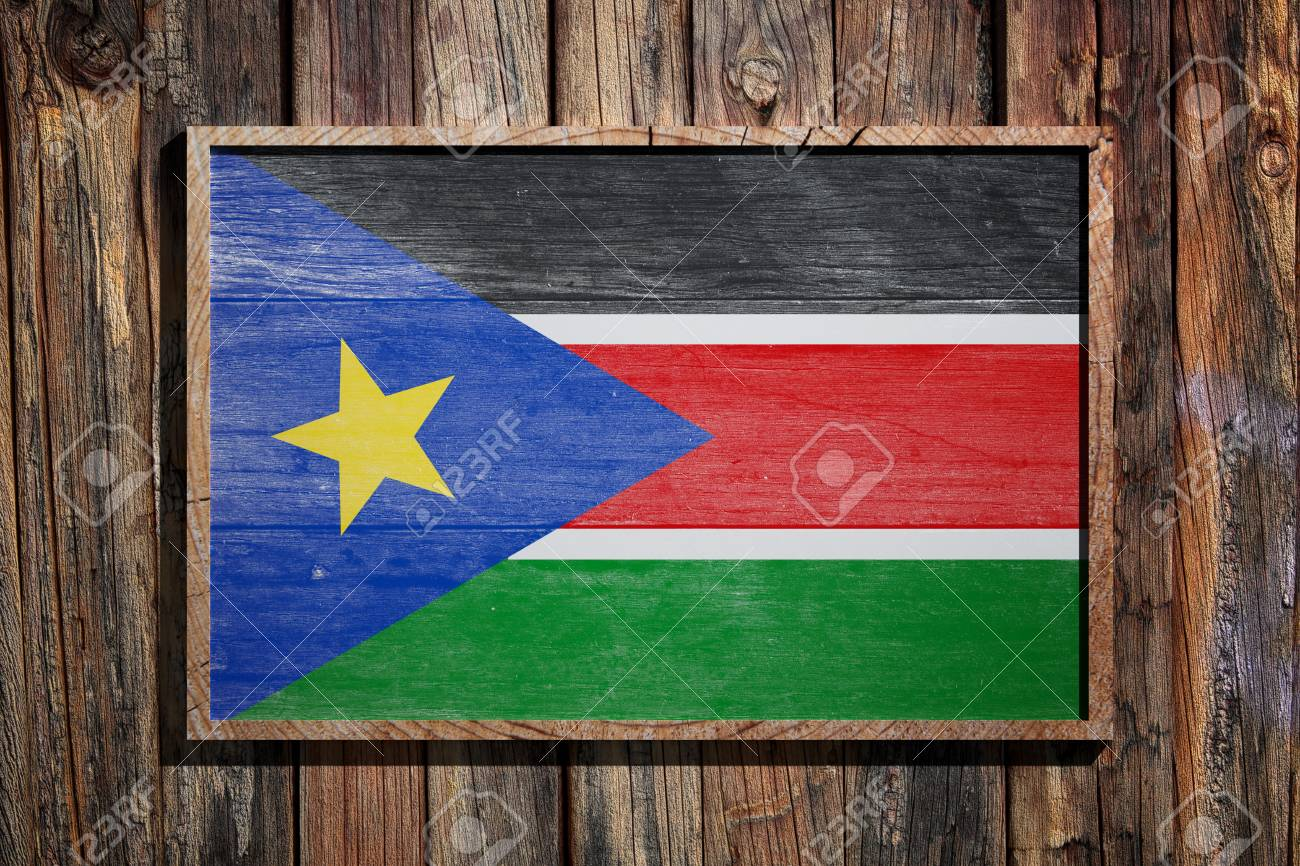 3d Rendering Of South Sudan Flag On A Wooden Frame Over A Planks ...