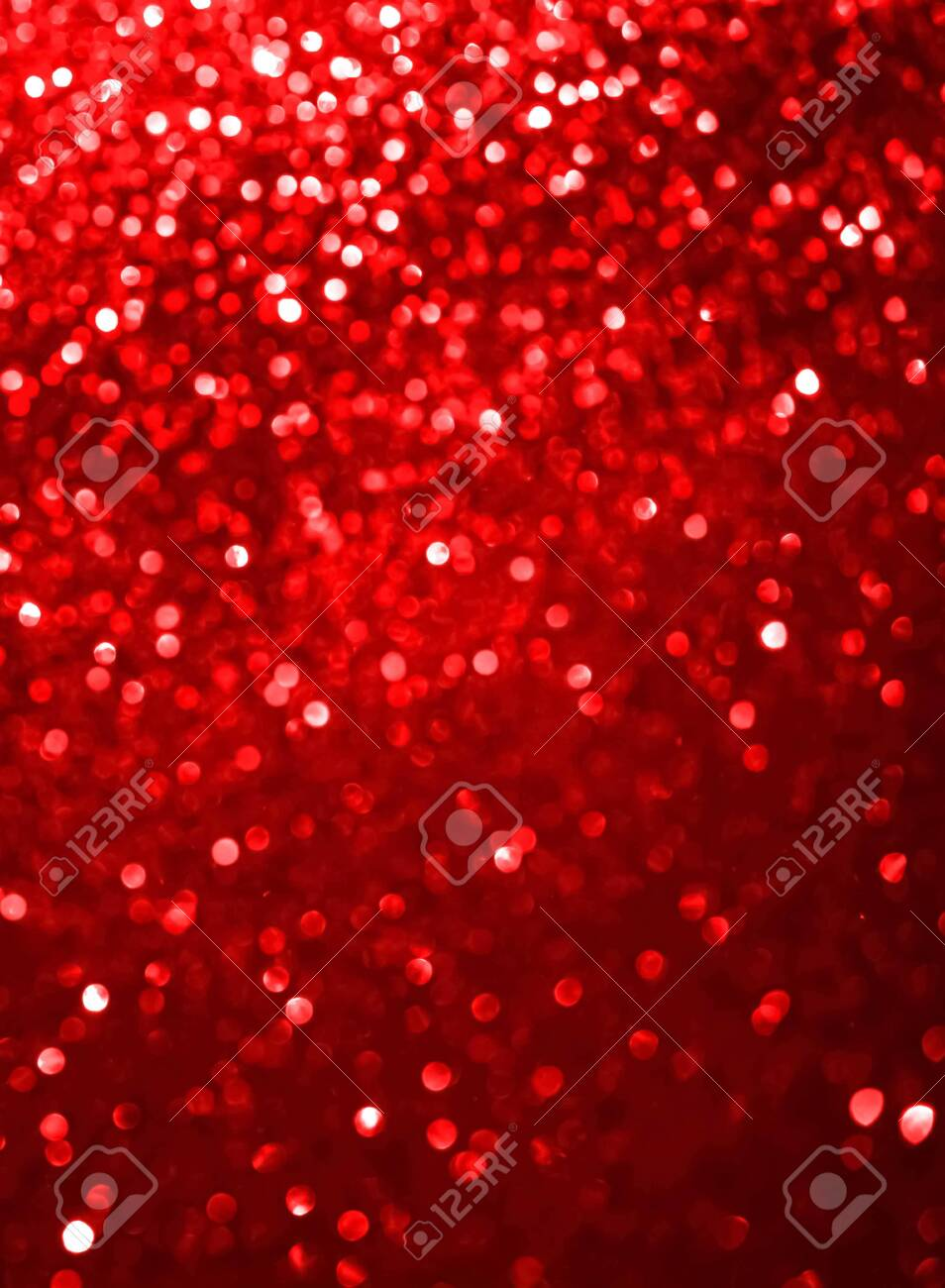 Abstract coral red defocused bokeh glitter sparkle confetti burst background. Festive concept.Vertical format. - 138626210