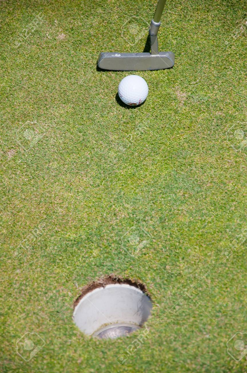 golf hole with ball and putt Stock Photo - 7507380