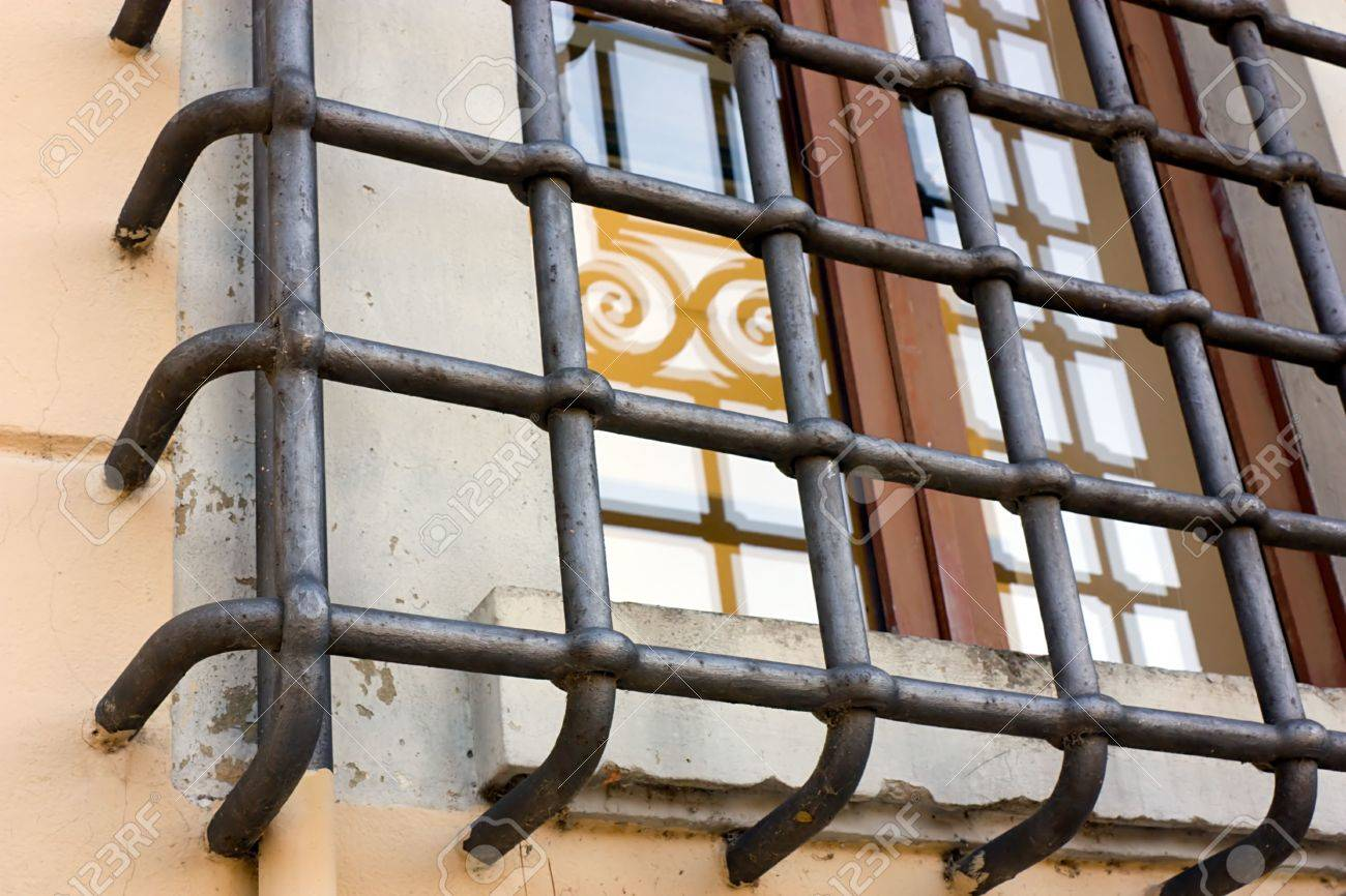 window of antique palace protected with a strong iron bars Stock Photo - 6075621