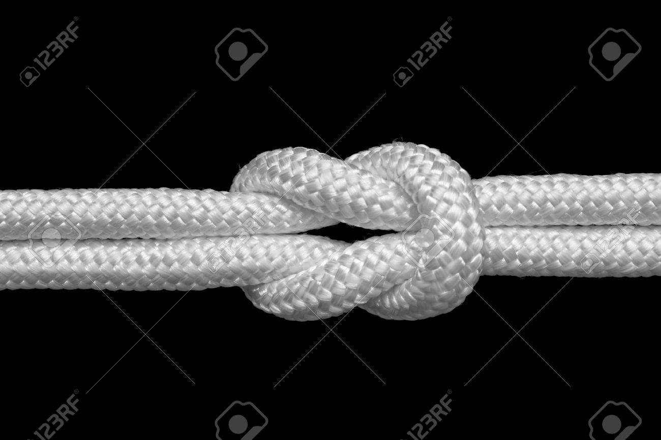 reef or square knot for join two ropes, isolated on black Stock Photo - 10419804