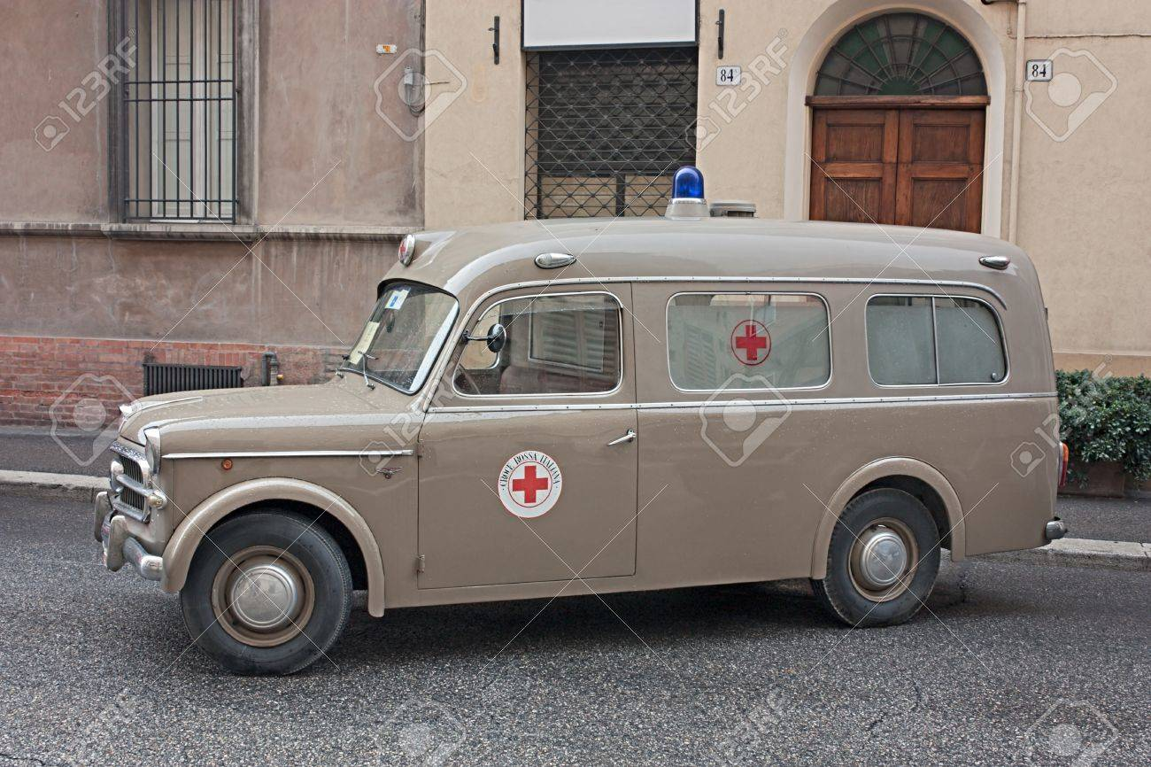 """FAENZA, ITALY - NOVEMBER 6: old italian ambulance Fiat 1100 (year 1957) exposed at """"Fiera di San Rocco"""" that hosts historical recalling, and various exposition, on November 6, 2011 in Faenza, RA, Italy. - 11229629"""