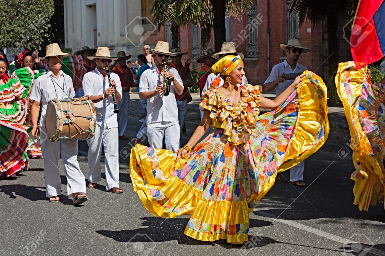street parade of ensemble Jocaycu from Colombia - colombian dancers in traditional dress performs popular dance during the International folk festival on August 5, 2012 in Russi, Ravenna, Italy Stock Photo - 14685878