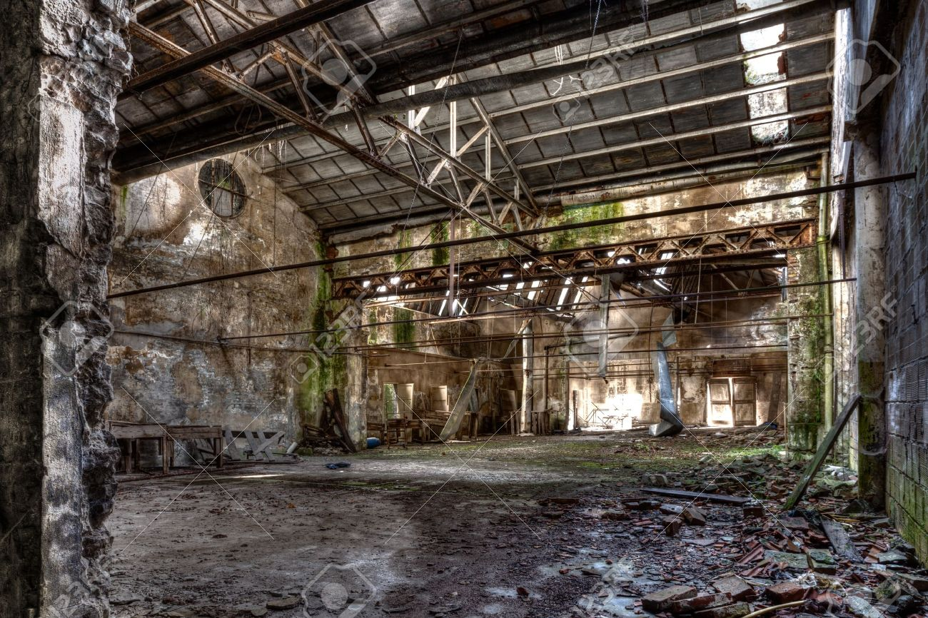 interior of abandoned factory with rubble and debris - desolate room of an old destroyed industrial warehouse - hdr image Stock Photo - 17194348