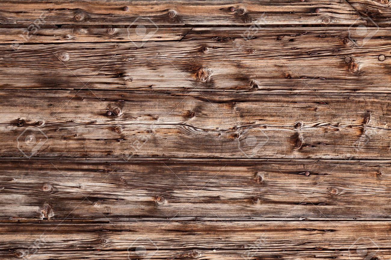 Old wooden boards as background - Old Rustic Plank Of Knotty Wood Background Texture Of Cracked Wooden Board Stock Photo