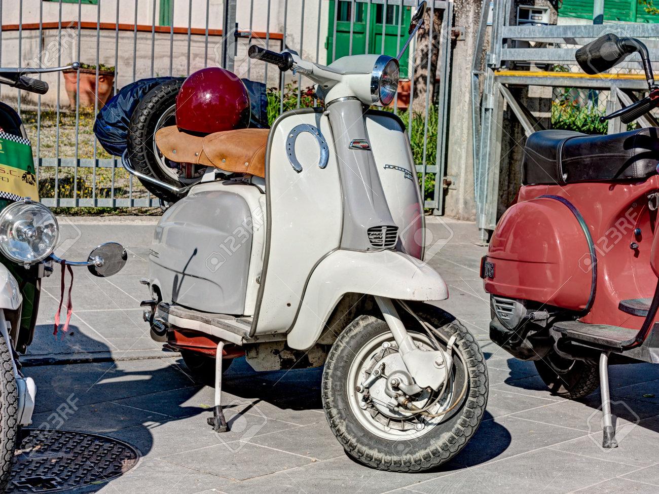 vintage italian scooter Lambretta with a lucky charm horseshoe, at motorcycle rally of Vespa Club Santarcangelo di Romagna, on April 9, 2012 in Poggio Berni (RN) Italy Stock Photo - 18799617