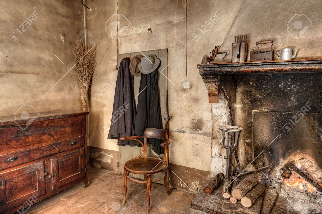Old times farmhouse interior of an old country house with old times farmhouse interior of an old country house with fireplace kitchen cupboard teraionfo
