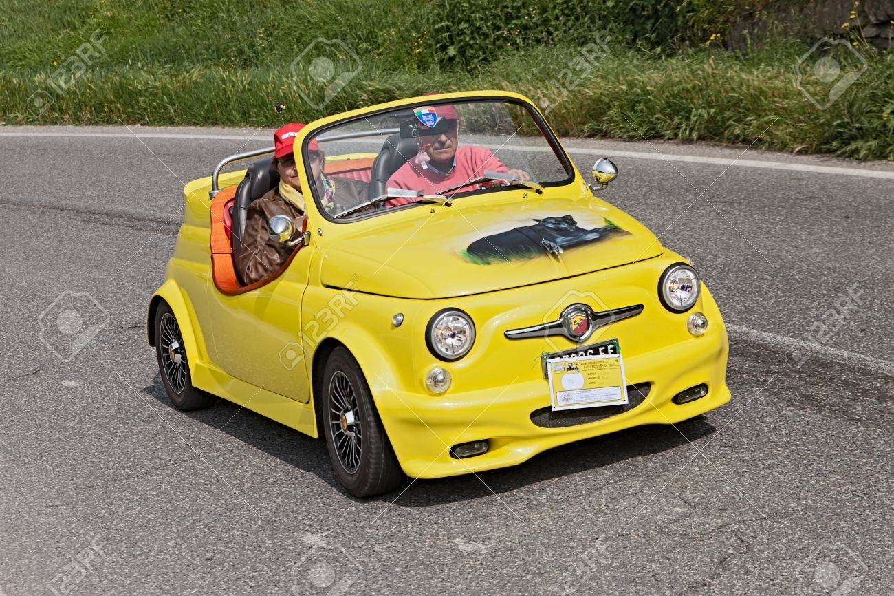 A Yellow Vintage Tuned Car Fiat Abarth Roadster Running In