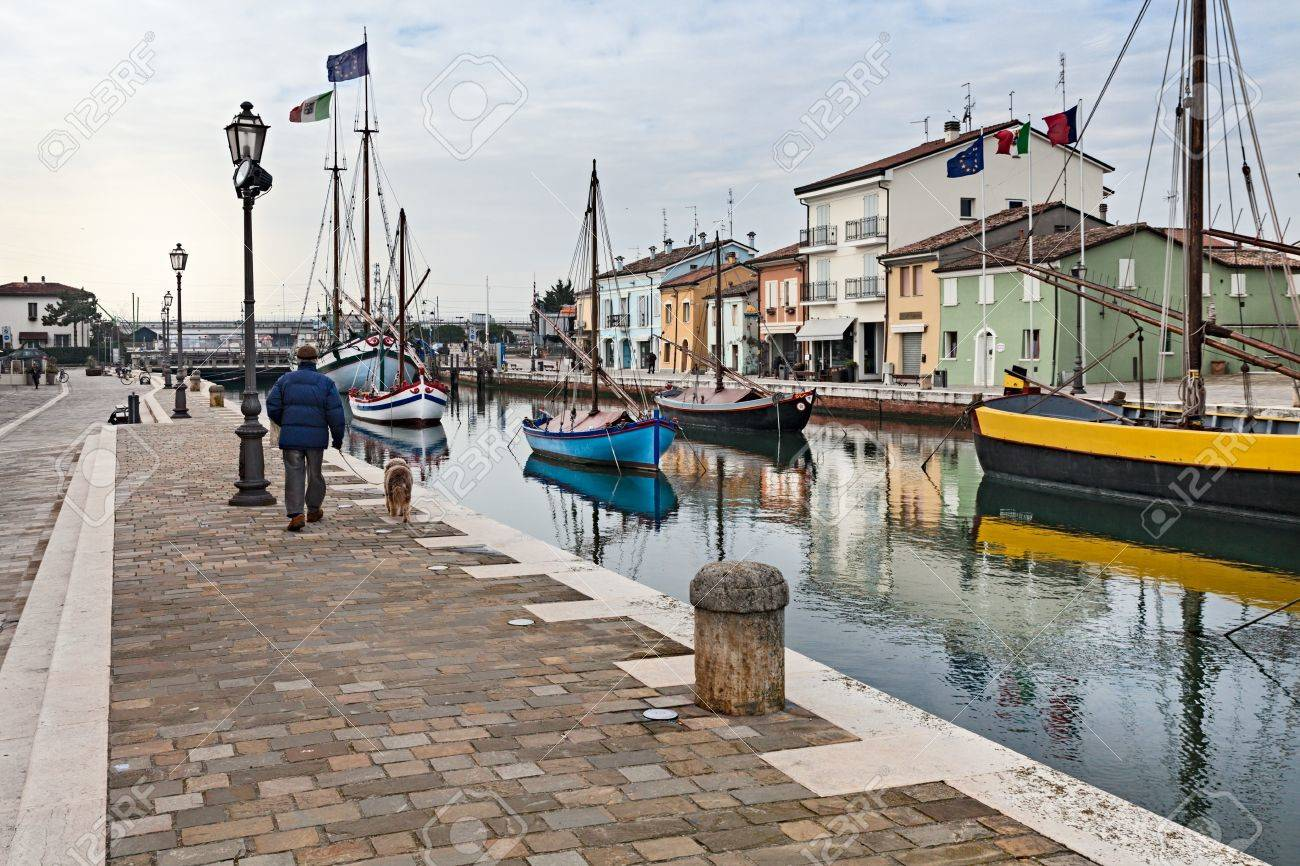 the dock of Cesenatico, seaside town in Italy, where ancient fishing sailing boats are displayed in the canal Stock Photo - 20747425
