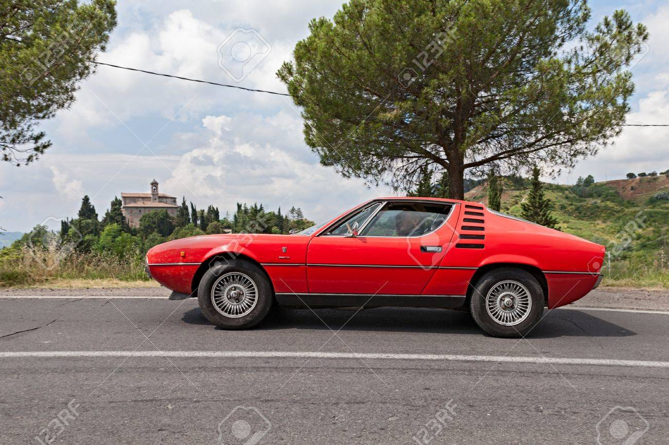 Vintage Car Alfa Romeo Montreal Runs On The Italian Hills During The Rally