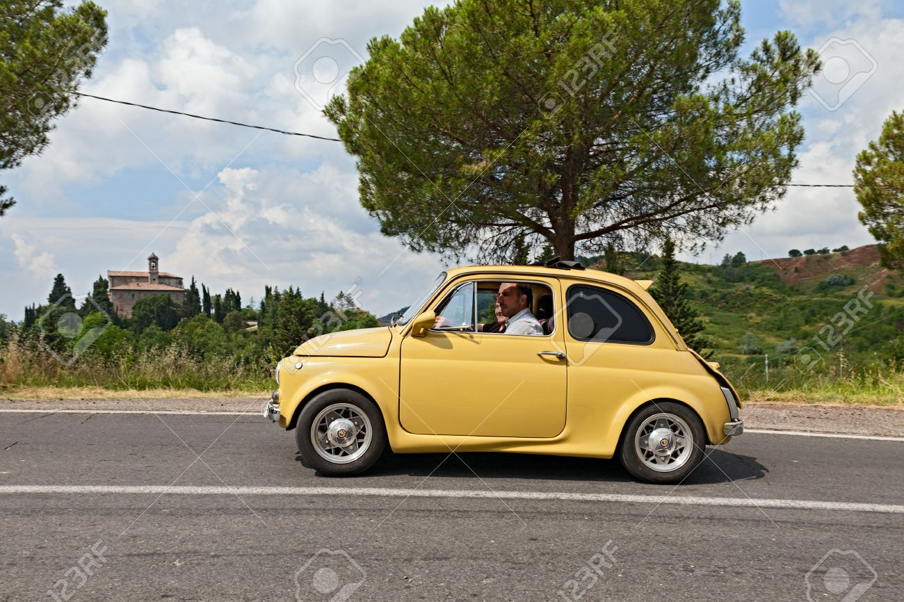 Vintage Tuned Car Fiat 500 Runs On The Italian Hills During The