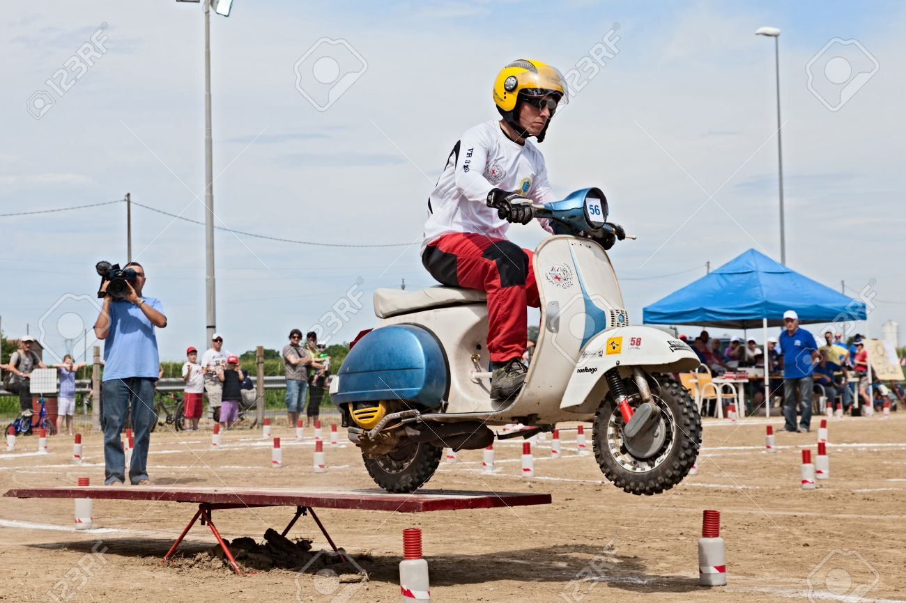 A Driver Engaged In Gymkhana Race Riding A Vintage Italian Scooter Stock Photo Picture And Royalty Free Image Image 21155934