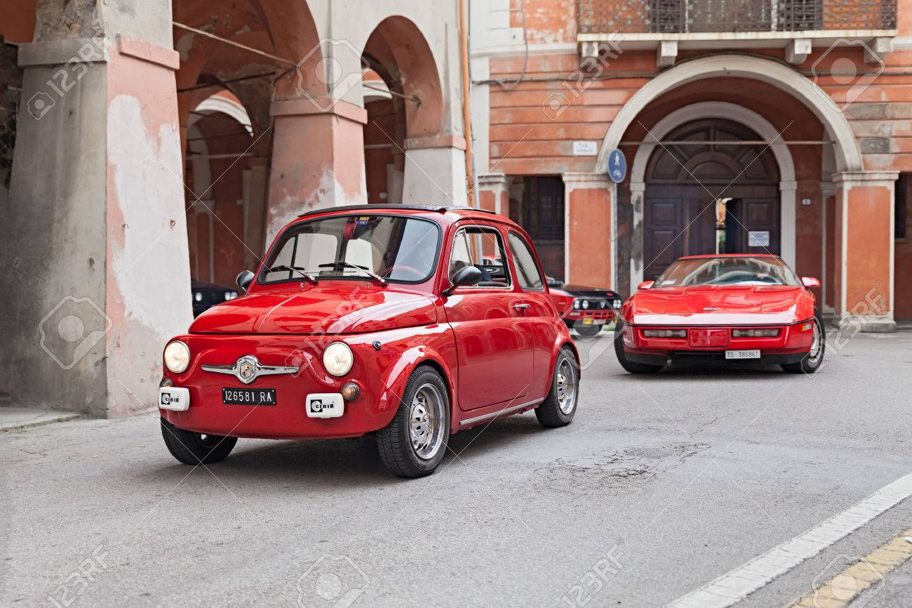 Red Vintage Car Fiat 500 Runs Along The City During The Rally