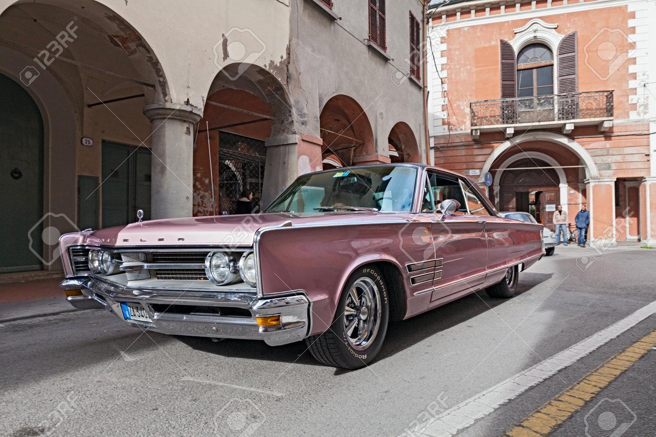 A Vintage Car Chrysler 300 Runs Along The City During The Rally