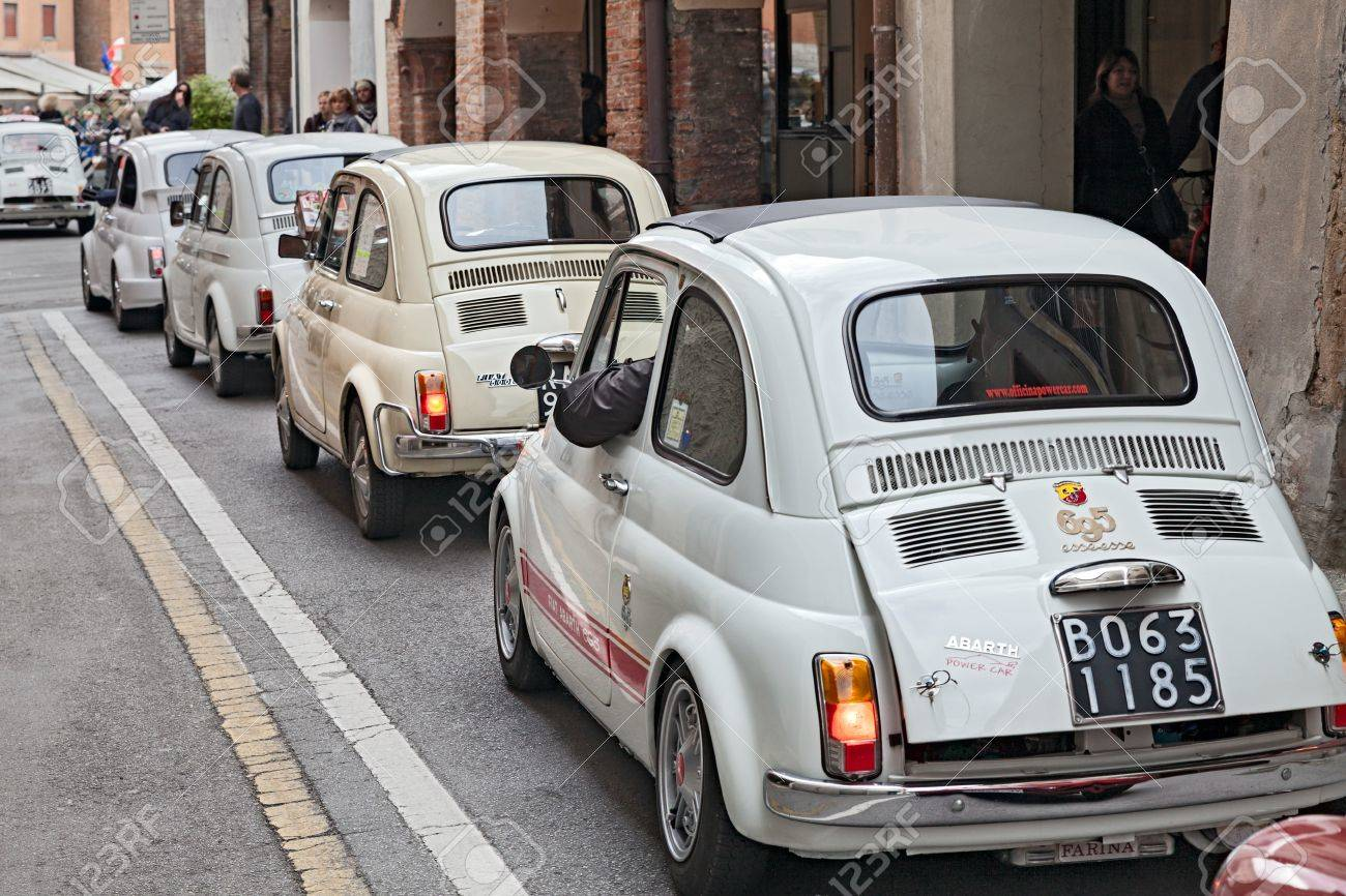 Line Of Vintage Small Cars Fiat 500 At Rally