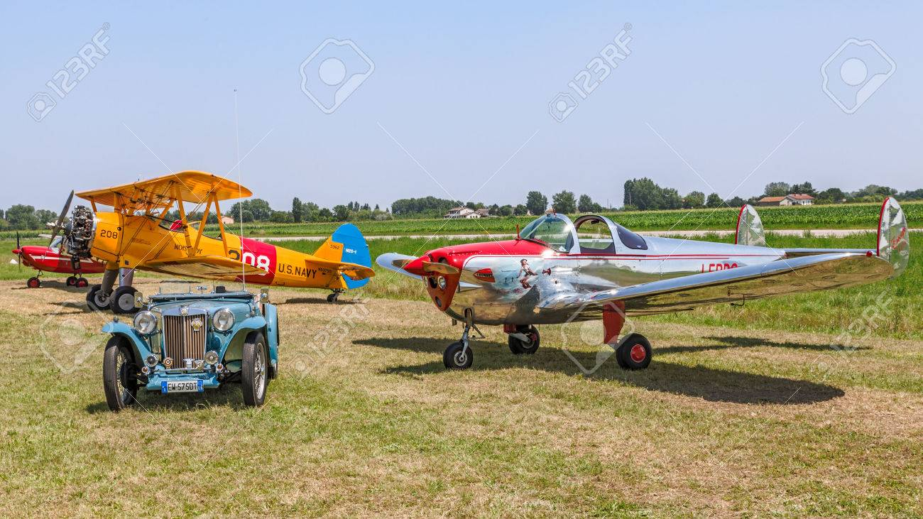 vintage car and airplanes exposed at festival Belle Epoque of Aero Club Lugo; MG TC Spider 1948 , Boeing Stearman Model 75, Erco Ercoupe 415D, Aermacchi MB 308, on June 7, 2014 in Lugo, RA, Italy - 29098694
