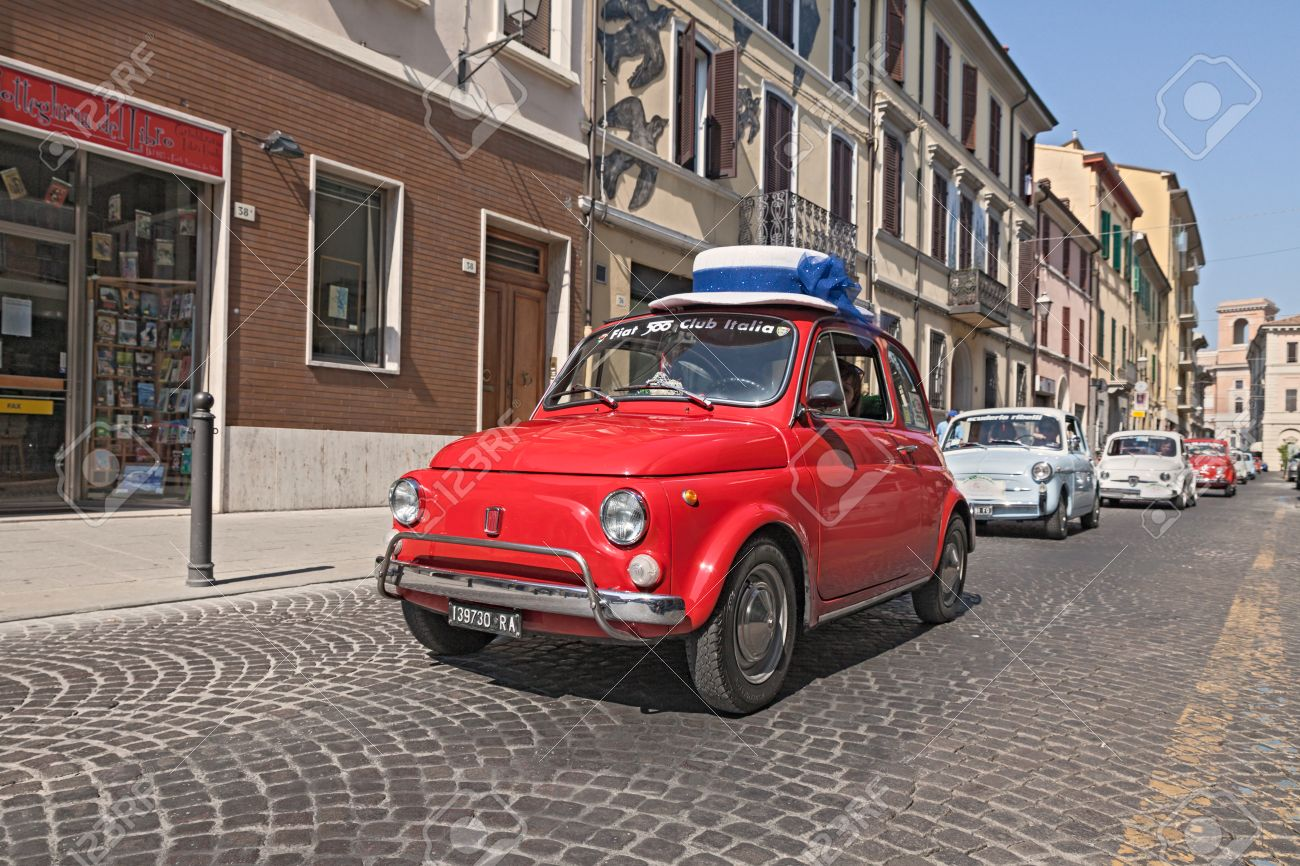 A Qoman Drive A Red Vintage Fiat 500 With A Funny Hat Lead A