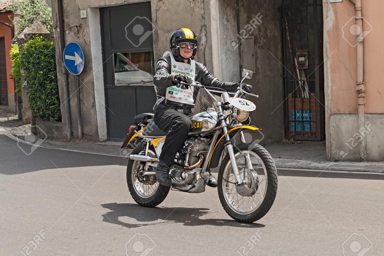 652976c8 Stock Photo - the biker Nigel Wanless rides a vintage italian motorcycle  Ducati RT 450 during the historic rally Motogiro d Italia 1914 - 2014 on  June 6, ...