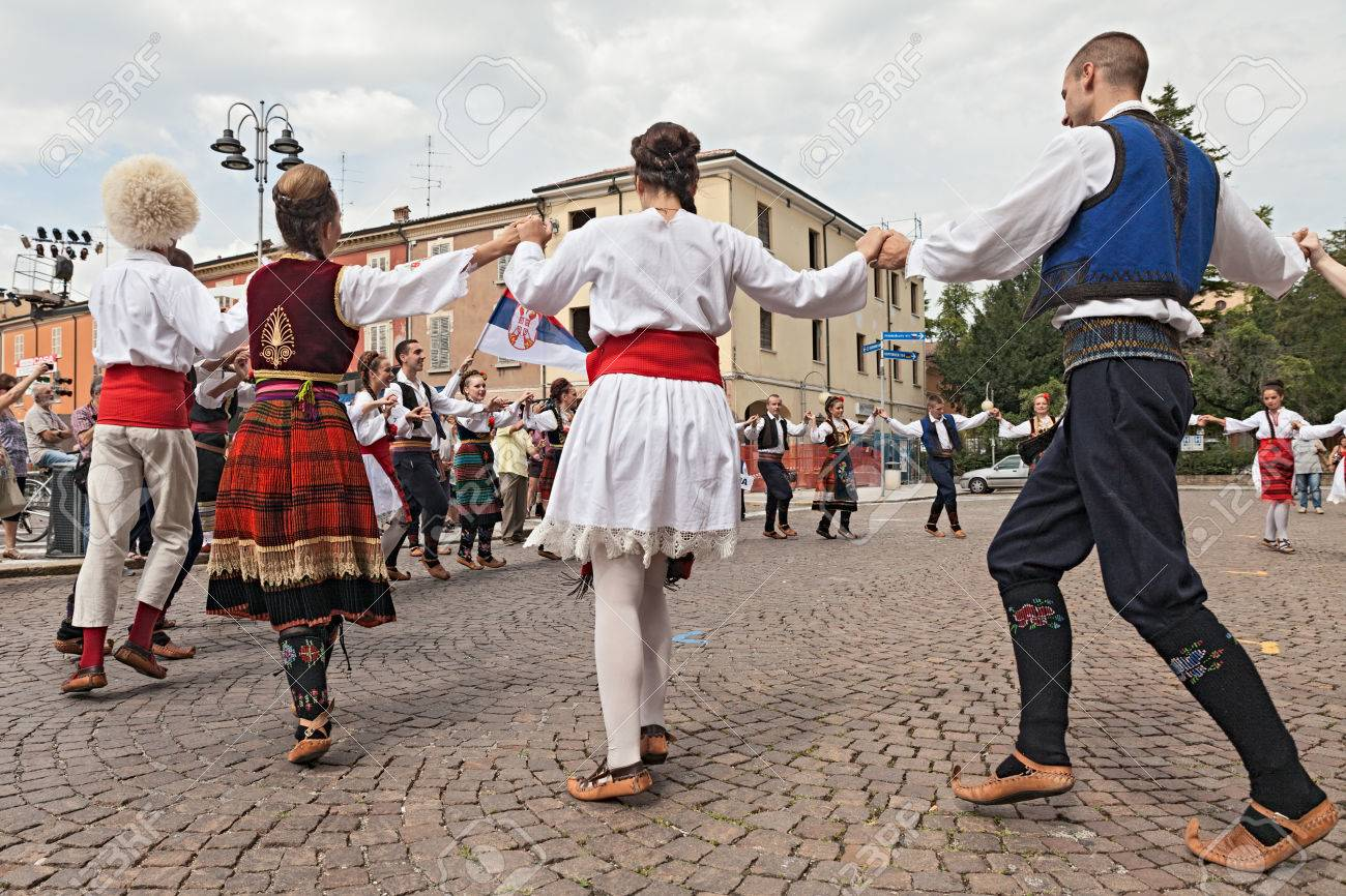 the folk dance group Folklore ensemble Saint George s Church from Belgrade, Serbia, performs popular circle dances in traditional dress at the International Folklore Festival of Russi, on August 3, 2014 in Russi, RA, Italy - 30948437