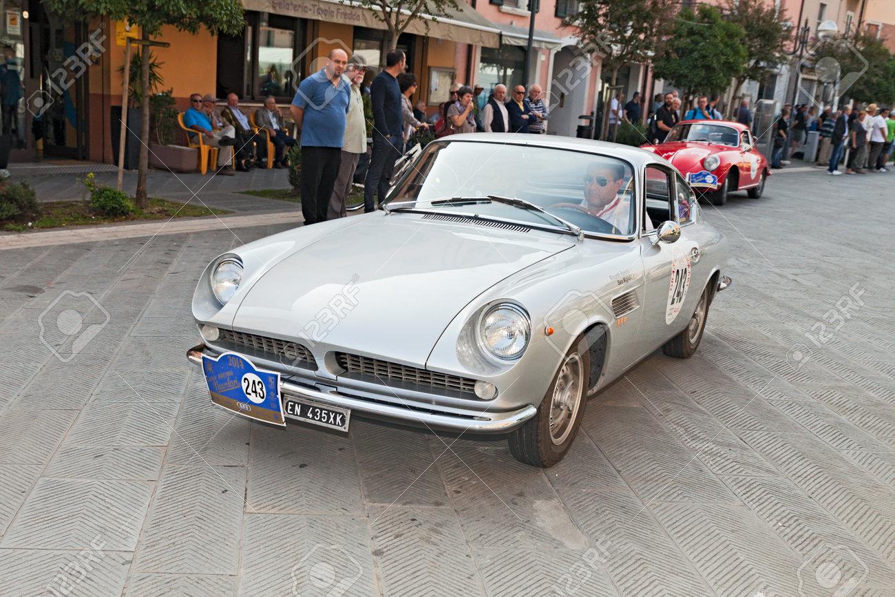 "the crew R. Roversi S. Miglioli on a vintage italian car ASA 1000 GT \\\\\\\""Ferrarina\\\\\\\"" (1964) designed by Ferrari, in historical race \\\\\\\""Gran Premio Nuvolari\\\\\\\"" on September 21, 2014 in Conselice, RA, Italy - 32164447"