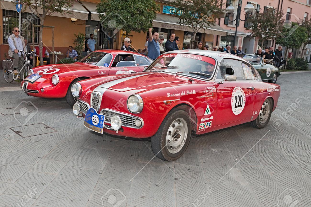 the crew monti - ballerio on a vintage racing car alfa romeo.. stock