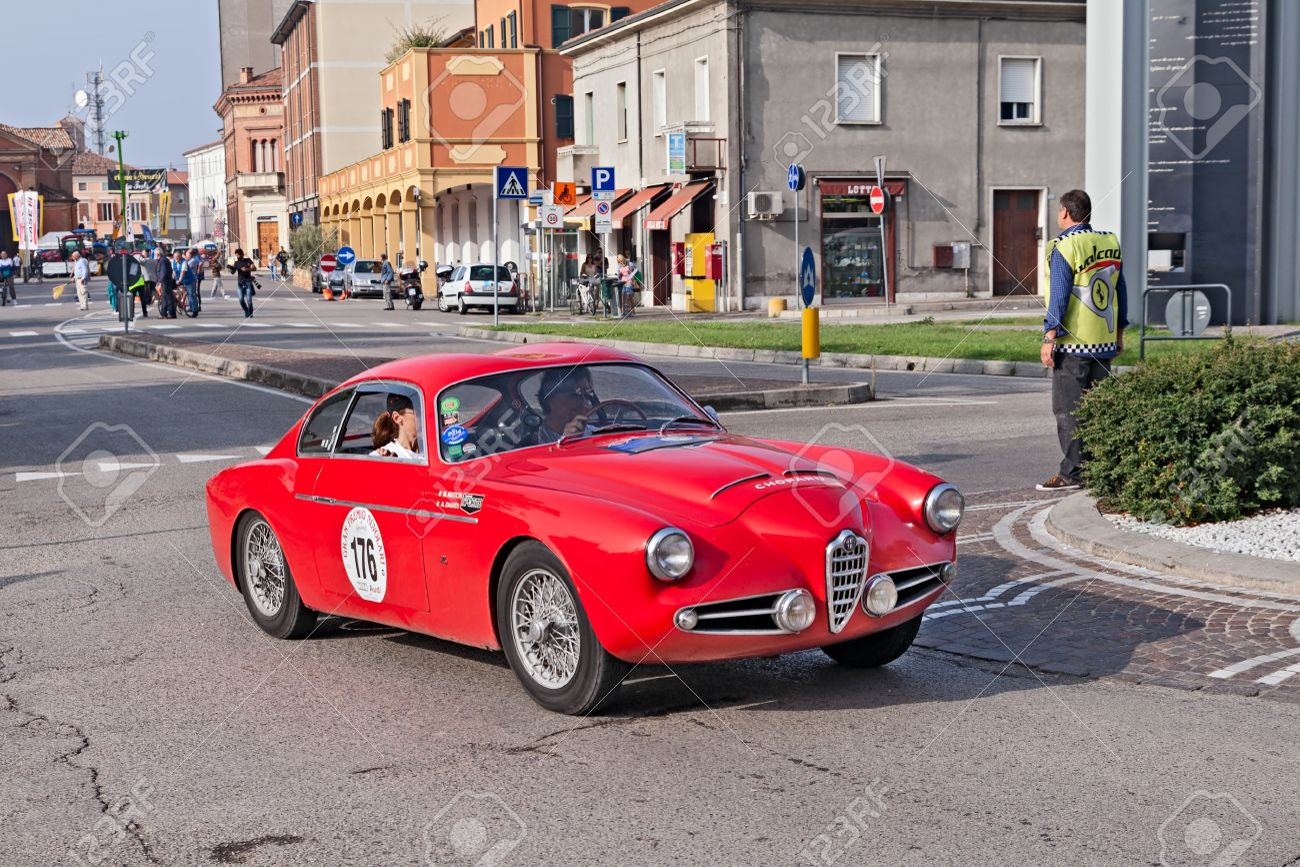 the crew m. rivolta a. zagato on a vintage racing car alfa romeo