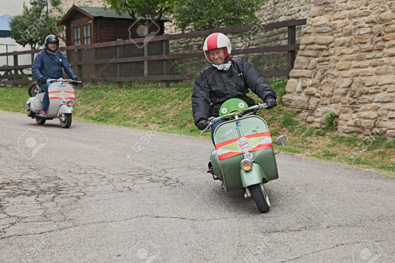 austrian biker riding a vintage italian scooter vespa piaggio