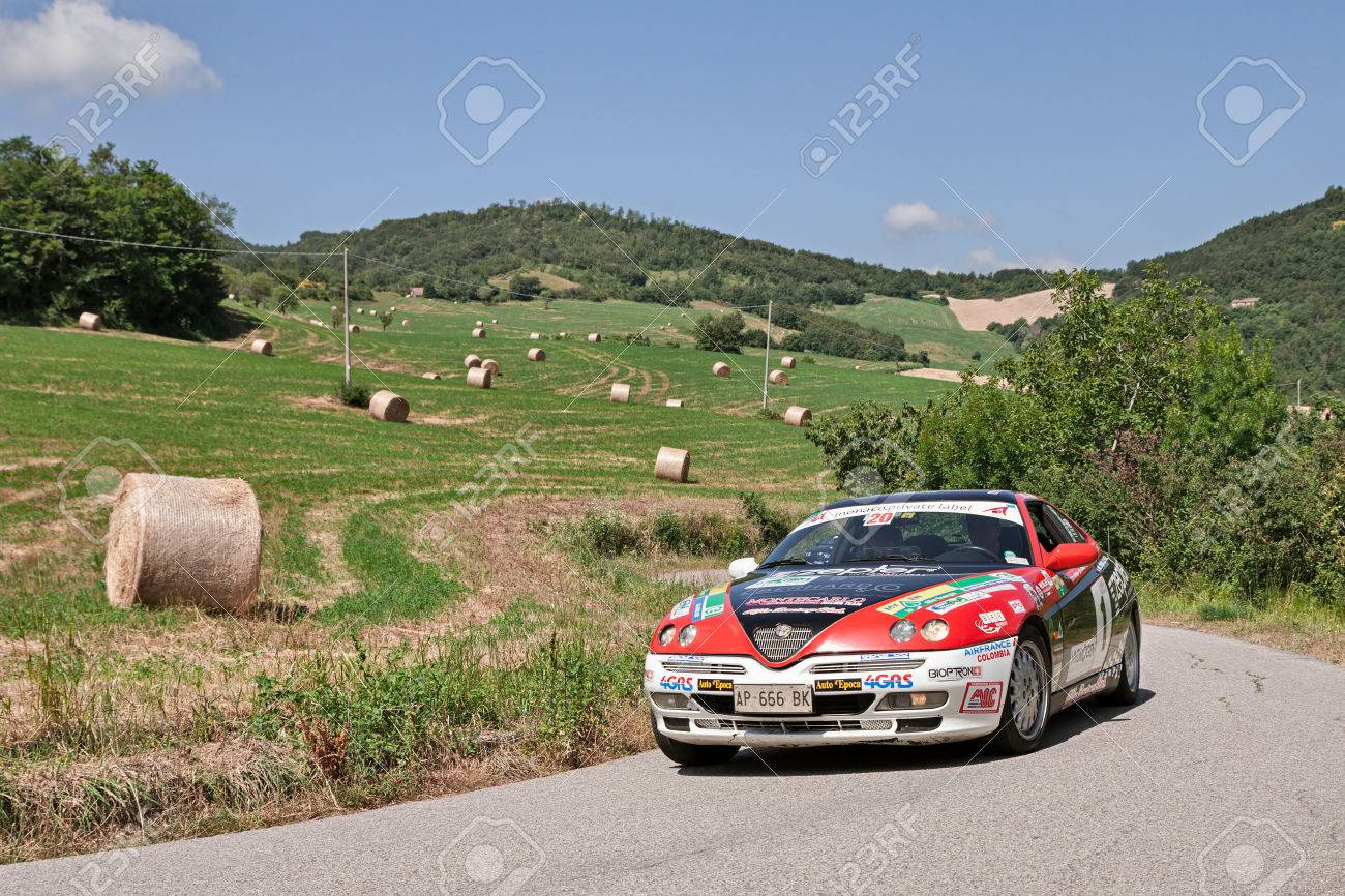 Driver And Co Driver On A Sports Car Alfa Romeo Gtv V6 Tb Traveling Stock Photo Picture And Royalty Free Image Image 59346508