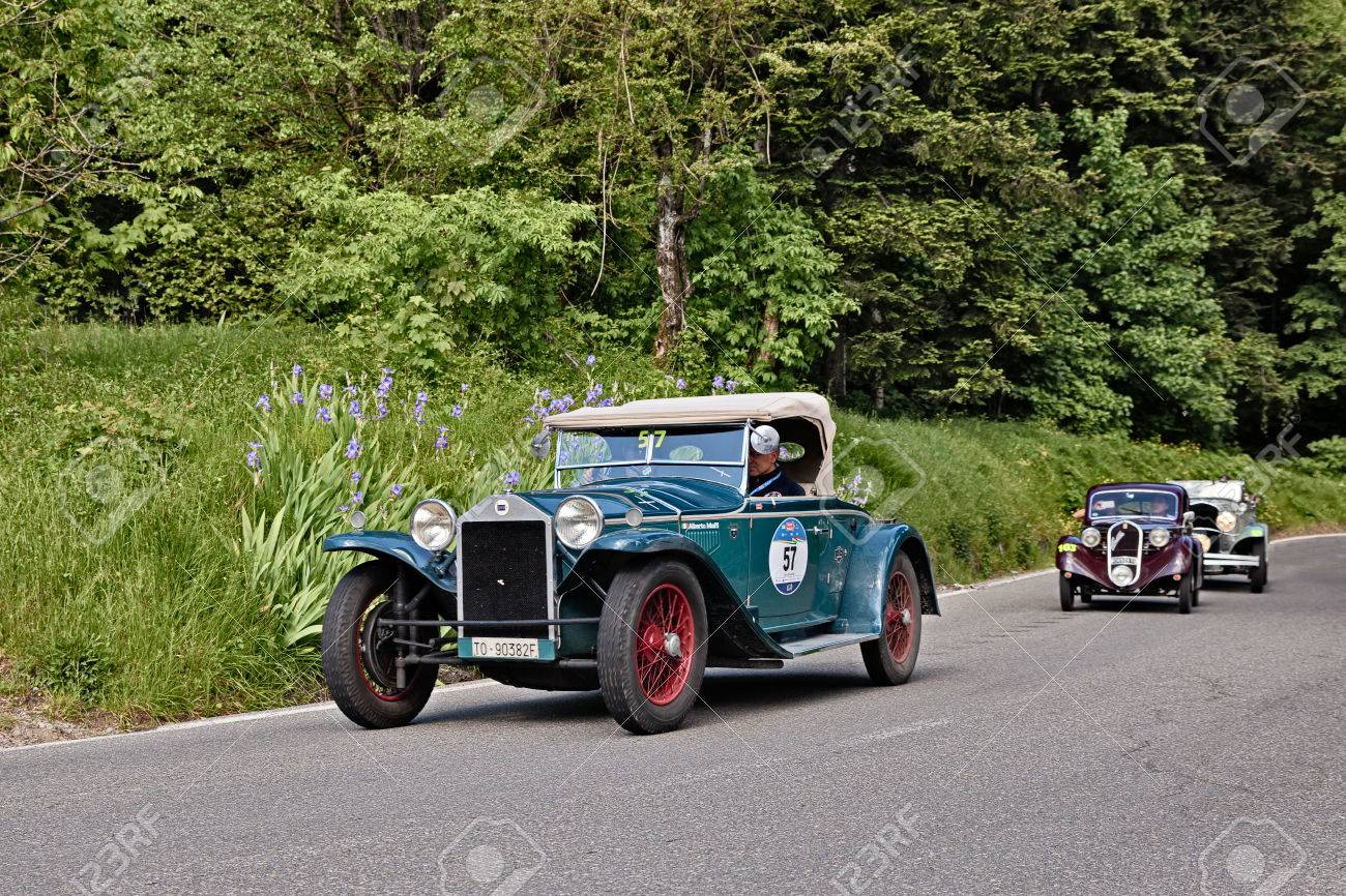 Driver And Co-driver On A Vintage Lancia Lambda Tipo 221 Spider ...