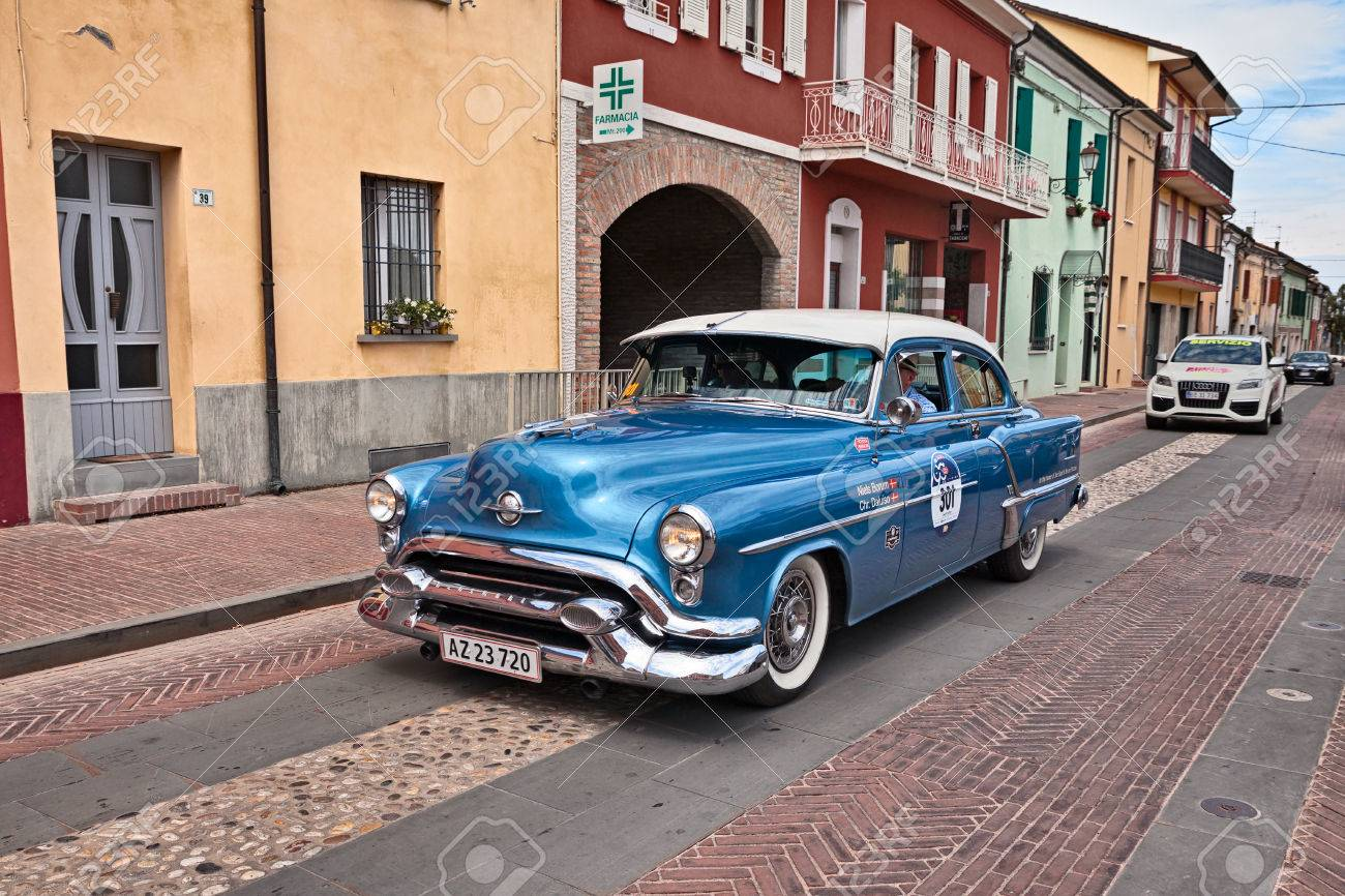 Driver And Co-driver On A Vintage American Car Oldsmobile 88.. Stock ...