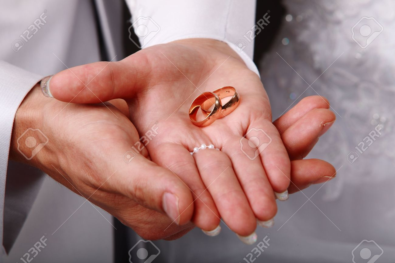 Image Of A Young Couple Holding Wedding Rings On Hands Stock Photo ...