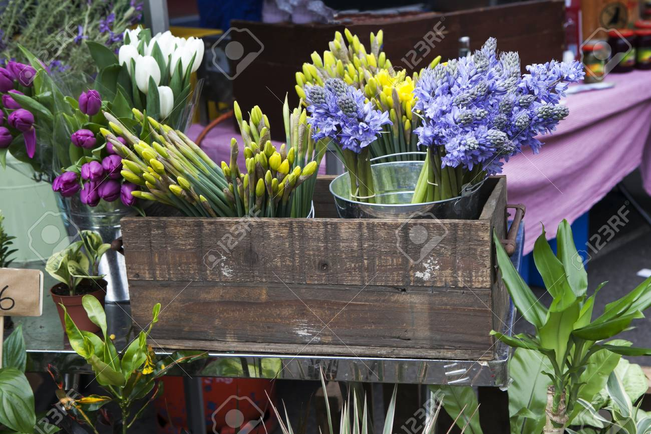 Variety Of Spring Flowers In Pots On Display In Shop Stock Photo