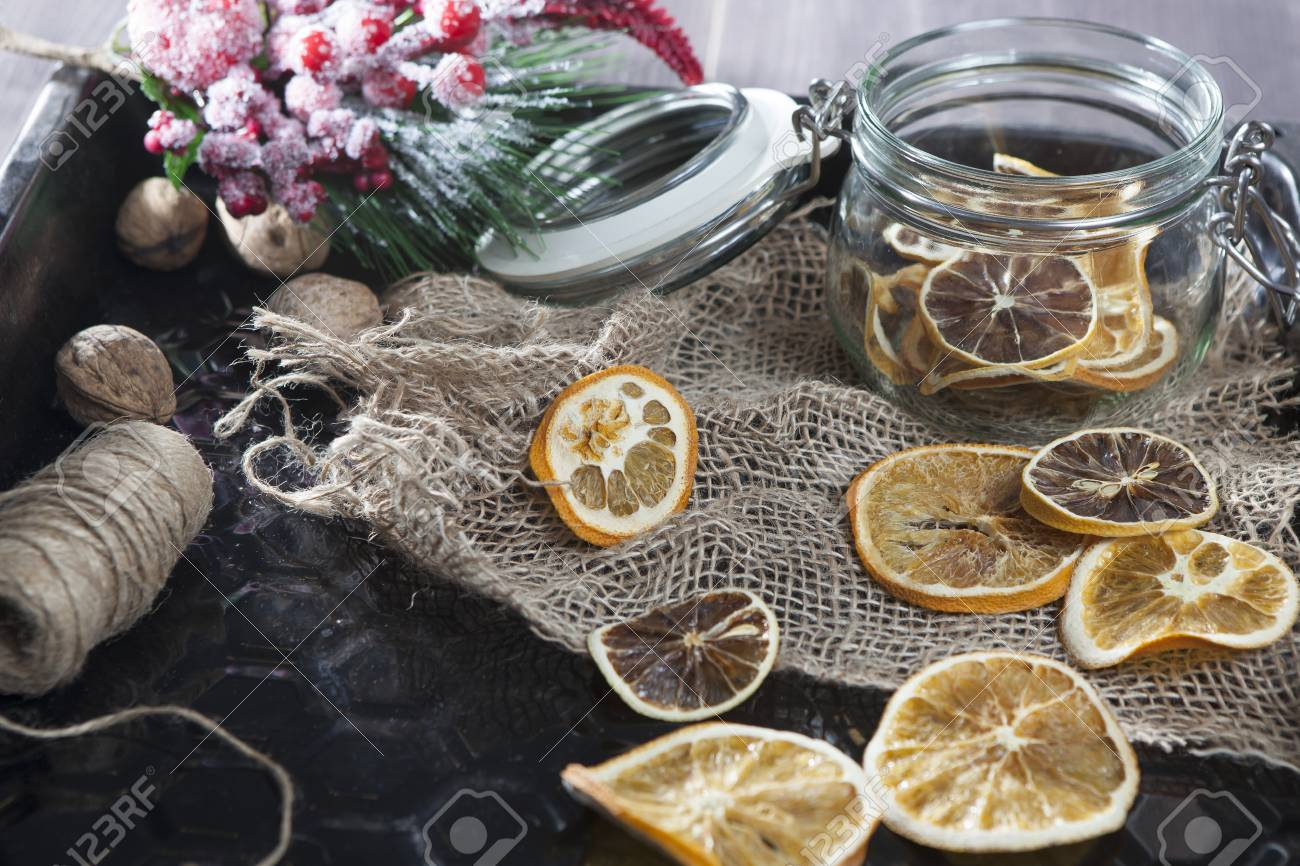 Glass Jar With Dry Orange Slices With Christmas Decorations Stock
